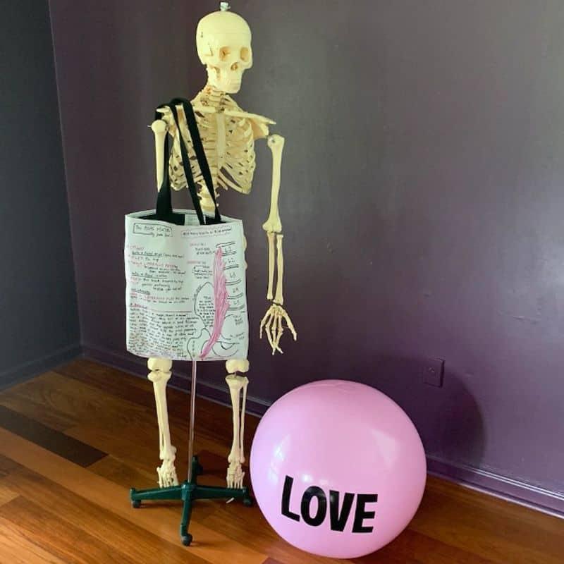 skeleton and love integrate together for an integrative coach not just a wellness coach