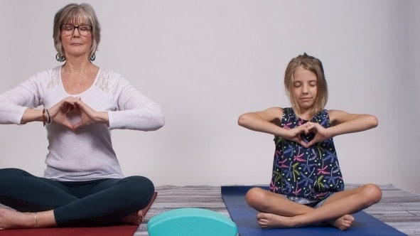 Theresa and girl posing for heart centered yoga