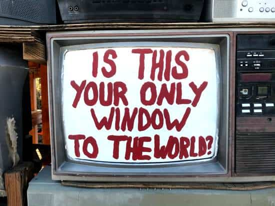 Old tv demonstrating cynicism with words of is this your only window to the world