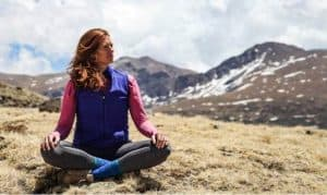 April yoga posing mountains Colorado