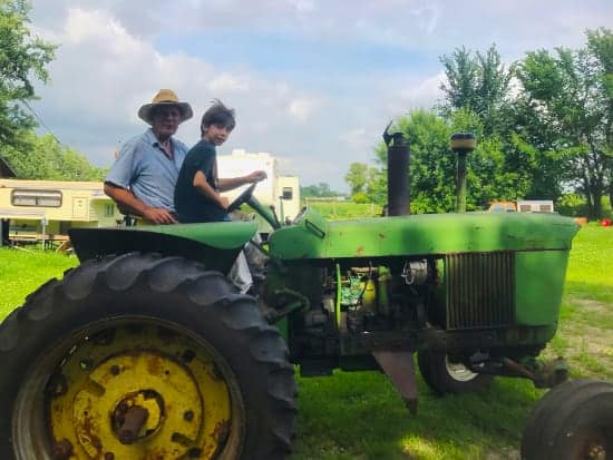 grandpa and nephew on tractor in South Dakota